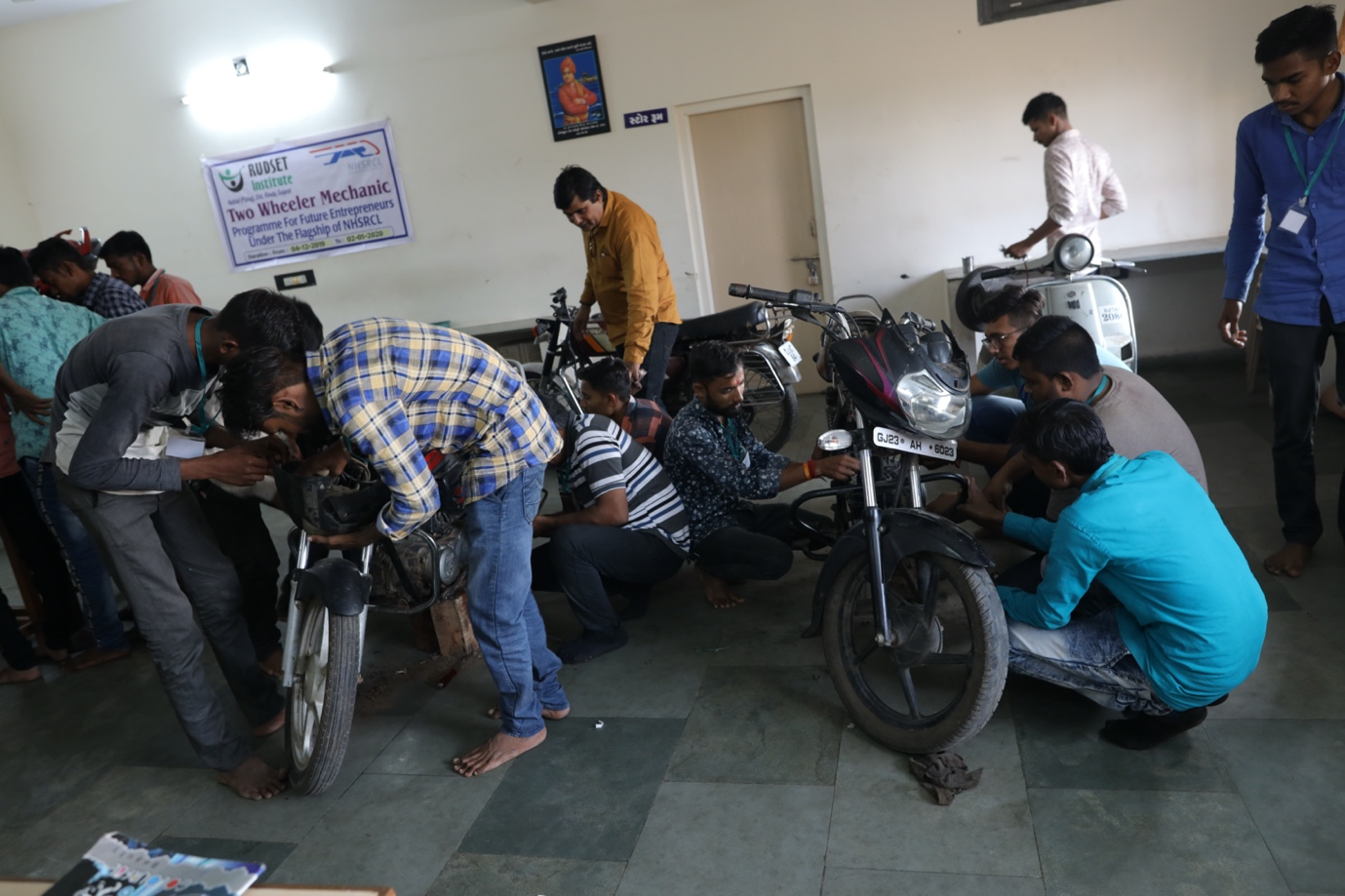 Trainees undergoing two wheeler mechanic training in Kheda (Gujarat)
