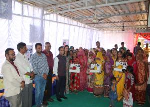 Sewing machine distribution to IRP training participants in Ahmedabad on 6th March 2020.