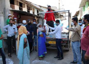 Food items being delivered to daily wage earners and tribal families in Bharuch district