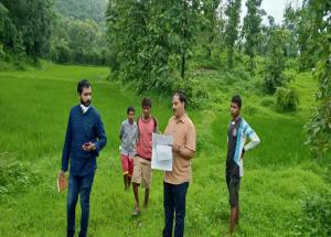 NHSRCL team verifying the land for preparing file for sale deed in Village Ambesari, Dahanu Taluka (Maharashtra)